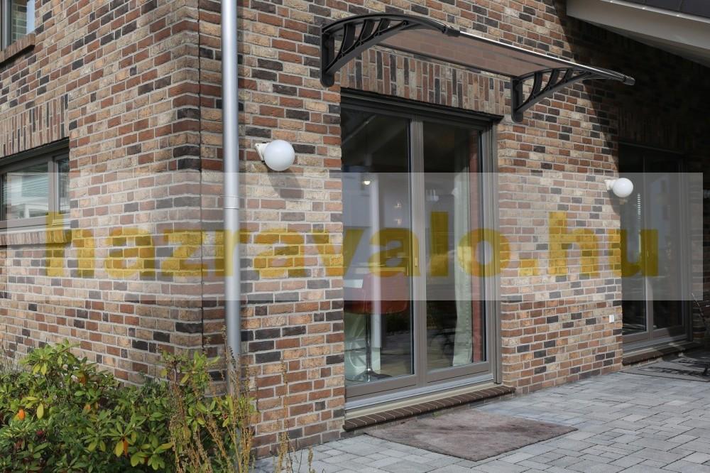 Esővédő tető CELLOX polikarbonát 120x100 barna tartókeret tömör víztiszta bronz tetőlap például bejárati ajtó vagy ablakok fölé. Szállítás könnyített csomagolás
